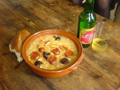 Fabada asturiana and sidra (cider), a typical dish of Asturias
