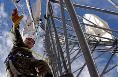 Tech from 142nd Fighter Wing working on a communications tower