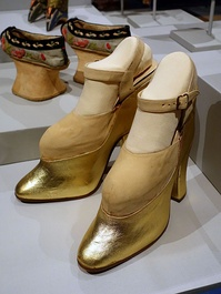 "A pair of ""trick"" platform shoes worn by West in films to make her look taller, which also contributed to her unique walk"