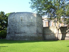 Roman wall and the west corner tower of the fort at York, with medieval additions