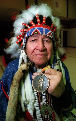 A member of Oglala Sioux with one of the original Indian Peace Medals that were given out by the Lewis and Clark Expedition to Native American leaders between 1804 and 1806