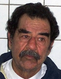 Saddam Hussein shortly after capture by American forces, and after being shaved to confirm his identity