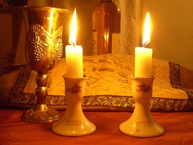 Shabbat candles and kiddush cup