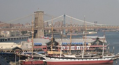 South Street Seaport, with the Brooklyn Bridge, Manhattan Bridge, and Williamsburg Bridge visible in the background