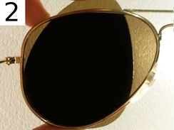 One can test whether sunglasses are polarized by looking through two pairs, with one perpendicular to the other. If both are polarized, all light will be blocked.