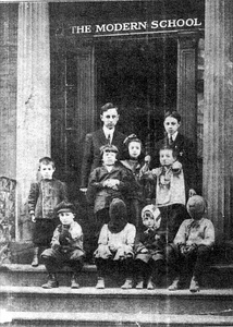 The NYC Modern School, ca. 1911–1912, Principal Will Durant and pupils. This photograph was the cover of the first issue of The Modern School magazine.