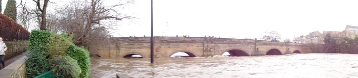 Wetherby Bridge during Storm Eva with the river level reaching almost the top of the arches.