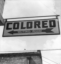"Sign for ""colored"" waiting room at a Greyhound bus terminal in Rome, Georgia, 1943."