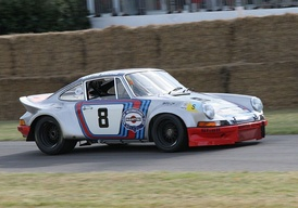 Targa Florio winning 1973 Porsche 911 Carrera RSR in Martini Racing colours at the 2006 Goodwood Festival of Speed.