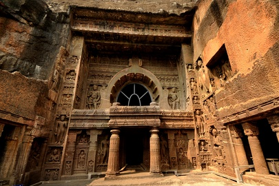 The Ajanta Caves are 30 rock-cut Buddhist cave monument built under the Vakatakas.
