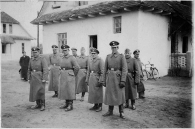 SS personnel at the Bełżec extermination camp, 1942. The SS was the leading Nazi organisation involved in the extermination of 5.5 to 6 million Jews[1]