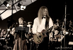Therion's Lori Lewis and Christofer Johnsson with symphonic orchestra and choir during the live classical show at the Miskolc Opera Festival, Hungary, 2007.