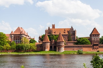 Malbork Castle in Poland, built by the Teutonic Knights in 1440, is the largest brick structure in the world.