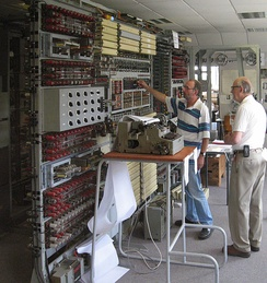 Tony Sale supervising the breaking of an enciphered message with the completed Colossus computer rebuild in 2006 at The National Museum of Computing