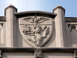 Duquesne University's coat of arms is carved in high relief above Canevin Hall.