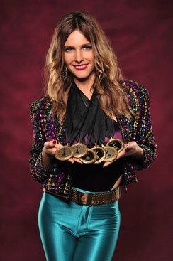 Brazilian actress Fernanda Lima holding Rede Globo's six medals of nominations to the International Emmy Awards in 2012