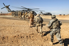 U.S. Army and Iraqi army soldiers board a Marine Corps CH-53E Super Stallion helicopter in Camp Ramadi, Iraq, 2009