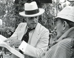 Giannini (left) with Luchino Visconti on the set of The Innocent (1976)