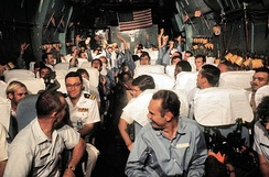 "Recently released United States POWs from North Vietnamese prison camps being flown on board the ""Hanoi Taxi"" from Hanoi, North Vietnam to Clark Air Base, Philippines, March 1973."