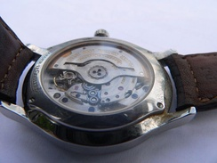 Automatic watch: An eccentric weight, called a rotor, swings with the movement of the wearer's body and winds the spring
