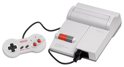 The NES-101 control deck alongside its similarly redesigned NES-039 game controller.