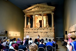 An actor and actress performing a play in front of the Nereid Monument, Room 17, the British Museum, London