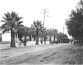 A streetcar of the Pacific Electric Railway makes a stop at Mission San Gabriel Arcángel c. 1905.