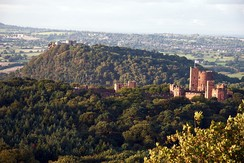 Peckforton Castle, Cheshire, with Beeston Castle in the distance