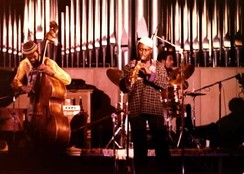 As Coltrane's interest in jazz became experimental, he added Pharoah Sanders (center; circa 1978) to his ensemble.