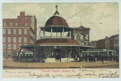 Trolley transfer station in its original location at the intersection of Main and Main streets; from a postcard sent in 1906