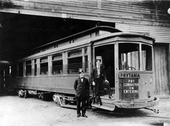 New Orleans Public Service's Prytania streetcar line, 1907. Two uniformed men stand by entrance, presumably the motorman and the conductor. Streetcar is probably at Prytania Station carbarn.