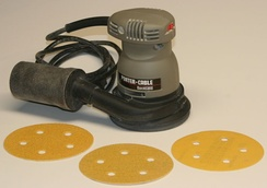 A random orbit sander, with disks of various grit sizes