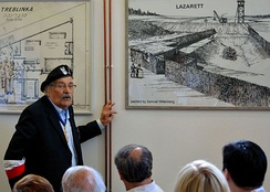 "Survivor Samuel Willenberg presenting his drawings of Treblinka II in the Museum of Struggle and Martyrdom at the site of the camp. On the right, the ""Lazarett"" killing station."
