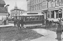 Seattle's first streetcar, at the corner of Occidental and Yesler, 1884. All of the buildings visible in this picture were destroyed by fire five years later.