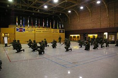 Army Reservists conduct weapons training in drill hall