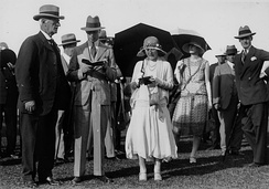 The Duke and Duchess (centre, reading programmes) at Eagle Farm Racecourse, Brisbane, 1927