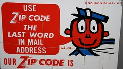A 1963 U.S. Post Office sign featuring Mr. ZIP.