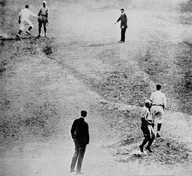 Bill Wambsganss (upper left) completing his unassisted triple play in Game 5, about to tag a stunned Otto Miller after touching second to double up Pete Kilduff (right foreground, touching third).