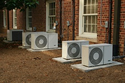 Air conditioning condenser units outside a building
