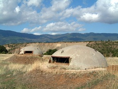 Bunkers in Albania built during Hoxha's rule to avert the possibility of external invasions. By 1983 approximately 173,371 concrete bunkers were scattered throughout the country.[14]
