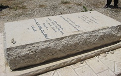 "Baruch Goldstein's tomb. The plaque reads ""To the holy Baruch Goldstein, who gave his life for the Jewish people, the Torah and the nation of Israel."""