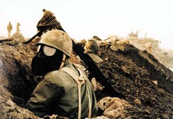 An Iranian soldier wearing a gas mask on the front-line during the Iran–Iraq War