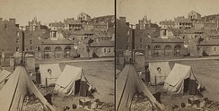 Contraband camp at Harpers Ferry, about 1861. Note John Brown's Fort in background.