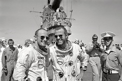 Pete Conrad and Gordon Cooper on deck of recovery carrier USS Lake Champlain after Gemini 5 mission