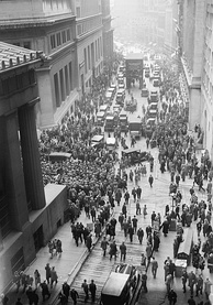 "A crowd at Wall and Broad streets after the 1929 crash. The New York Stock Exchange is on the right. The majority of people are congregating in Wall Street on the left between the ""House of Morgan"" (23 Wall Street) and Federal Hall National Memorial (26 Wall Street)."
