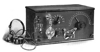 De Forest's first commercial Audion receiver, the RJ6 which came out in 1914.  The Audion tube was always mounted upside down, with its delicate filament loop hanging down, so it did not sag and touch the other electrodes in the tube.