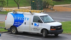 DirecTV service van in Ypsilanti Township, Michigan. DirecTV equipment is installed and maintained by private contractors such as Multiband, as shown here. In most areas of the United States, installation, upgrades, and service are performed by DirecTV Home Services, a division of DirecTV corporate.