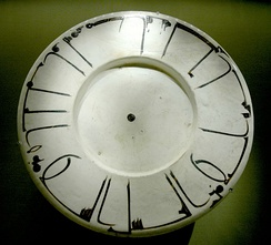"Dish with epigraphic decoration. The Kufic inscription reads: ""Magnanimity has first a bitter taste, but at the end it tastes sweeter than honey. Good health [to the owner]."" Terracotta, white slip ground and slip underglaze decoration, Khurasan (Iran), 11th–12th century."