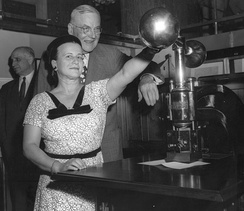Clydia Mae Richardson, who led the effort to put the seal on display, and John Foster Dulles imprint a document during the 1955 ceremony