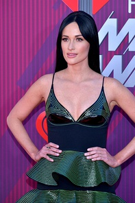 Kacey Musgraves became one of the most controversial figures in contemporary country music.[142]